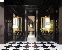 Black and white tiled floor, mirrored entryway