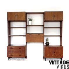 [:en]Vintage wall unit from Simplalux with various cupboards and shelves of teak[:nl]Vintage wandsysteem