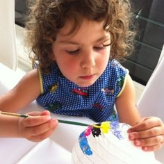 Let children paint mini paper lanterns for pretty decorations they can be proud of.