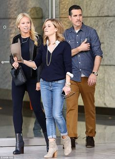 Mother-of-three: Reese - born Laura Jeanne - looked preppy and polished in her navy jumper, cuffed blue jeans, and beige booties