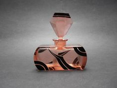 This beautiful perfume bottle is very detailed and artistic timeless Art Deco design. It was made from heavy crystal pink glass, hand cut, enameled, polished and matted by Karl Palda Glassworks in Northern Bohemia in the 1930's.