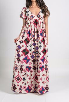 Oversize maxi dress, featuring a plunging V-neckline & a pattern uniquely designed for Karavan Clothing. Inspired by a Moroccan rug, this bohemian dress can