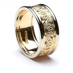 In this version of the beautiful Triscele design Celtic wedding ring, our craftsmen have enhanced the elegant yellow gold band with a contrasting white gold trim on each side. Or if you prefer, the ring is available in all yellow gold. Choose from 10k or 14k gold and of course each ring will be hallmarked by the Dublin Assay Office, your assurance of quality. The Triscele was a very sacred symbol to the Celts, it symbolizes the eternal rhythm of life. Nessa was the mother of Conchobhar…