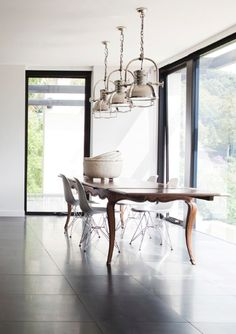 love the mix of industrial / modern with traditional dining table