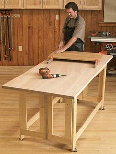 "Folding Work Table Woodworking Plan The 1x4 base construction, topped with a hollow-core door, make it easy to single-handedly make room in the garage for the family car. Or, for use as an outfeed table, simply build it 1/8"" less than the height of your tablesaw."