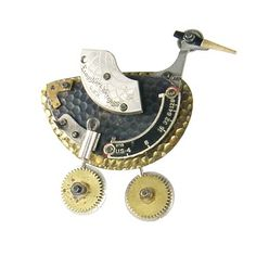 """Bird Brooch Brooch with fishing lures, camera parts, watch parts, clock hand, wire, and other recycled and found objects. Approx. 3""""x3""""  Chris Giffin"""