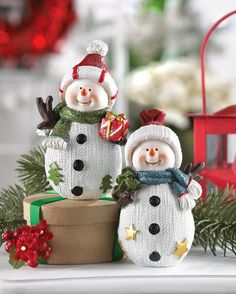 Decorate your holiday tabletop with these merry little snowmen figurines. This darling duo features knitted texture on their bodies, sparkling scarves, cute caps and faces that are hard to resist. They are sure to bring glad tidings to your home this season! Rosy cheeks and carrot noses are just the start of this duo's adorable charm!