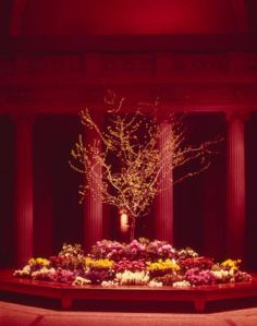 View of Easter plantings in the Great Hall of the Metropolitan Museum of Art. Photograph from 1975. | #metmuseum #greathall #easter #flowers #1975