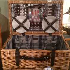 this picnic basket serves four, which makes it perfect for an outdoor double date, a family outing, or a much much classier tailgating party. $145. see you at the shop. 80 south broadway, tarrytown, ny 10591. prettyfunnyvintage.com