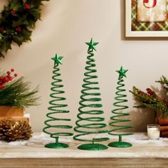 Our Green Swirl Trees are cute and simple and everything you need to decorate your home! #Kirklands #HollyJolly #holidaydecor #KirklandsHoliday