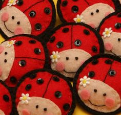Felt ladybugs.  Could be made as Christmas decorations.