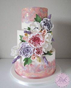 Pastel watercolour and sugar flowers wedding cake with gold leaf #chocolateweddingcakes