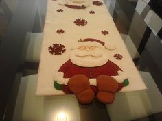 Santa table runner feet hang over Christmas Patchwork, Christmas Sewing, Felt Christmas, Christmas Projects, Holiday Crafts, Christmas Time, Christmas Ornaments, Holiday Decor, Christmas Door