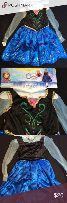 Disney Frozen Anna Halloween Costume Disney Frozen Anna Halloween/Dress Up  Costume. Gold sequin trim on velour vest. Glittery flowers in skirt. Velcro closure in back. Includes petticoat, headband and cape.           All costumes $20   2 for $30 or 3 for $40 Disney Costumes Halloween