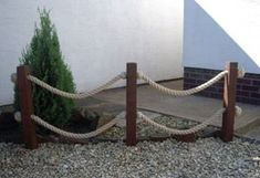 Instead of rope, braided grapevine.  marine rope fence - Google Search