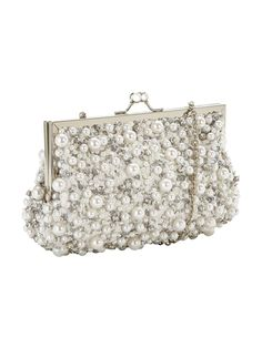 V by Very Pearl Detail Frame Clutch Bag - Cream Perfect for summer weddings and extra special events - this pearl detail frame clutch bag from V by Very is the epitome of luxe accessorising! Covered in crystals pearls and sequins, it brings sophisticated glam to your occasion edit, and the separate phone pocket keeps your essentials organised too.  Styling Ideas Keep it elegant with a flowing maxi dress metallic heels. Gorgeous! Material Content: 100% PolyesterBags Style: ClutchInside…