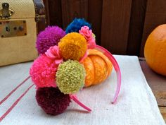 Pom Pom Headpiece by Ninety9RedBalloons on Etsy Doesn't have to be just for littles but cute for teens as well.