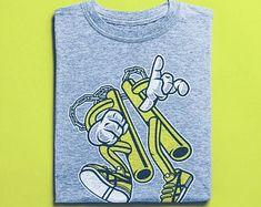 View Surf Shirts by BuyVintageShirts on Etsy Skater Shirts, T Shirts, Stick Man, Good Birthday Presents, Surf Shirt, Graffiti, African Safari, Vintage Shirts, Tshirts Online
