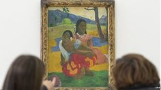 "Two women look at the painting ""Nafea faa ipoipo"" (When will you marry?, 1892) by French painter Paul Gauguin on display in the Fondation Beyeler in Riehen, Switzerland, 06 February 2015 ( A new world record selling for almost 300 million to a museum in Qatar!!!!)"