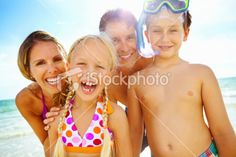 Happy family enjoying time on the beach Royalty Free Stock Photo