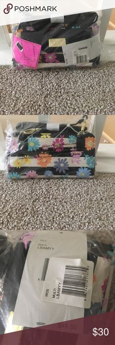 """Luv Betsey Crossbody Black and white stripe with floral pattern. Removable crossbody strap. Exterior had a magnetic flap closure pocket. Zippered main compartment includes a zippered center divider and four card slots. ImMeasurements: Bottom W: 8""""D: 1 """"H:4 1⁄4"""" Strap Length: 50"""" Strap Drop: 24"""" Betsey Johnson Bags Crossbody Bags"""