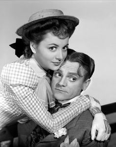 """A promotional photo: Jimmy with co-star Olivia de Havilland in the 1941 production of 'Strawberry Blonde.""""  Although Cagney was a natural redhead, it was the third co-star, Rita Hayworth, who played the strawberry blonde."""