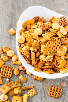 A classic snack mix of Chex cereal, cheesy fish and square crackers, pretzels, and oyster crackers is spiced up with Sriracha and red pepper flakes.