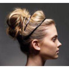 """""""First put hair in a medium to low ponytail. Then I split the pony in half and twist one of the two pieces into a small bun. With the other half, I do the same and put an elastic in both  """"Don't wash your hair the day before you do an updo. It stays better"""