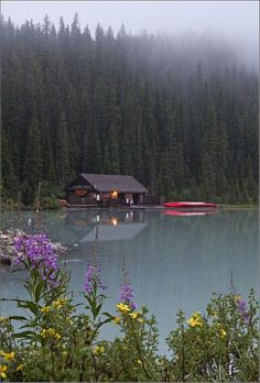 16 Great Photos of Best Places to Visit in Canada Cabin among the pines at Lake Louise, Banff National Park, Canada