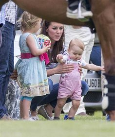 June 15, 2014 - Cirencester, Glos, United Kingdom - The Duchess of Cambridge and Prince George today watched Prince William and Harry play p...