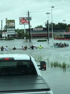 Houston, Texas residents in the aftermath of Hurricane Harvey flooding form a human chain to save man trapped in an SUV.
