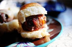 Sunday afternoon, I made sliders. I wrapped bacon around each diminutive patty of hamburger, then cooked them in the oven and squeezed them between small, warm rolls. And I wasn't the least bit sor...