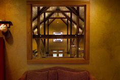 Loft window into party barn  from second floor with complex faux finish on walls. Designed by Sentient Architecture LLC Managing Partner, Christopher K. Travis.