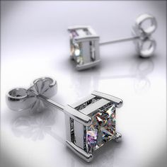 Pair of Ladies 18k White Gold 1/4ctw Classic 4 Prong Princess Cut Diamond Earrings. A pair of perfectly matched Princess cut diamonds set into a refined 18kt white gold four-prong mounting with a standard friction back posts. Each diamond is H-I in color and SI in clarity.