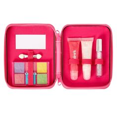 bright and colorful case contains make up that is just as bright and colorful. The rectangular case that is bedazzled with rainbow gem zips open to reveal an eyeshadow palette, a pink lip gloss, a clear lip gloss, and a glittery mascara. Clear Lip Gloss, Pink Lip Gloss, Makeup Gift Sets, Makeup Set, Barbie Accessories, Jewelry Accessories, Hot Pink Lipsticks, Kids Makeup, Luanna