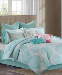 A contemporary medallion motif is brought to life with bright hues in the Echo Bindi comforter set. A white ground features an all-over medallion print in vibrant aqua for a modern bedroom update. | C