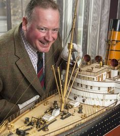 Auctioneer Charles Miller is pictured with the long model of the RMS Mauretania. It is being sold by Swan Hunter in May Titanic Ship, Rms Titanic, Scale Model Ships, Scale Models, Rms Mauretania, Titanic Model, Titanic Underwater, Hms Hood, Model Building