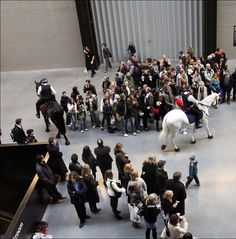 "Tania Bruguera - Tatlin's Whisper #5, 2008 - ""In this piece of performance art, two mounted police officers will enter the Turbine Hall and corral members of the public as if they were engaging in a demonstration. Exploring notions of power and public space, it's a performance that isn't timetabled and happens out of the blue"""