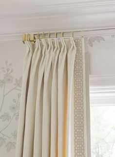 Pretty curtains (with detailed trim) and lovely  wallpaper for an elegant bedroom