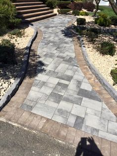 Where would your walkway lead you? This beautiful walkway features Cambridge Pavingstones and Wallstones with ArmorTec.