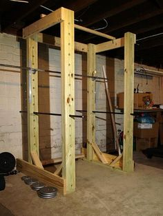 Homemade power rack made out of wood and pipe..