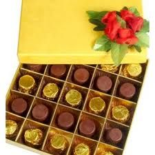 Assorted Premium chocolates  (Sweets)  Mouth watering assorted chocolates of different flavors in a gift box.