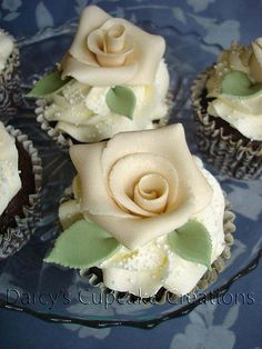 Mmmmm!!! White rose cupcakes. Almost too pretty to eat... almost.