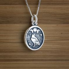 Raven and Triple Moon Charm - STERLING SILVER - (Just the charm, chains are sold separately.). $11.00, via Etsy.