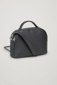 COS image 3 of Double-zip leather shoulder bag  in Black