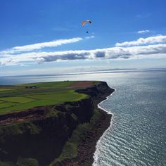 Chris flying towards St bees lighthouse with the Isle of Man in the distance