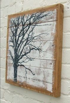 Bare branch tree painting on reclaimed plank wood. Nice artistic touch.