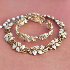 Good condition, Coro off white cream enamel leaf choker necklace and bracelet demi parure set. Coro mark on both pieces. Plating is worn on both