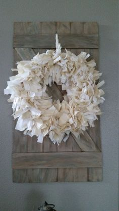 Living Room decor - rustic farmhouse style. Reclaimed wood shutter with rag wreath.