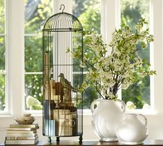Decorating with Old Bird Cages | love how they used books inside this birdcage display! via Pottery ...